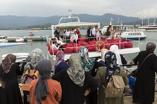 Georgia Batumi, Turkish tourists watching a Georgian wedding company