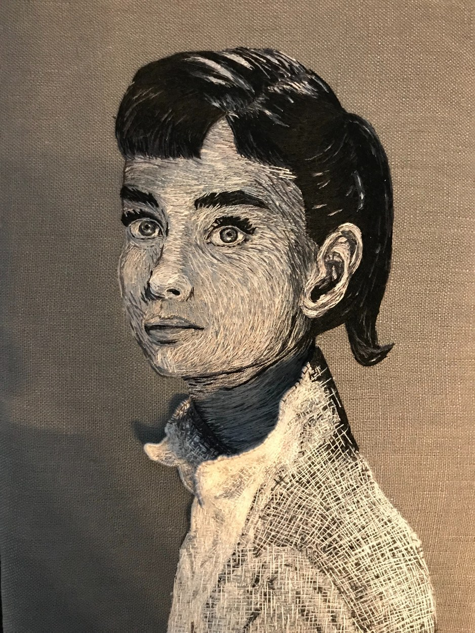 Migrant woman hastily clad in donated shirt (a portrait of Audrey Hepburn)