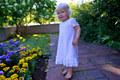 Vera 1 year, wondering the flowers